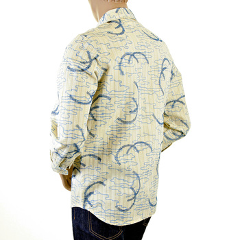 Etienne Ozeki almond with blue shirt ETIE2706